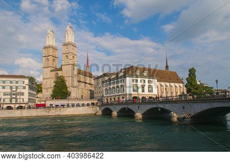 View Of Grossmunster Church, Townhall And Bridge Over Limmat River In Zurich Old Town, Zurich, Switz