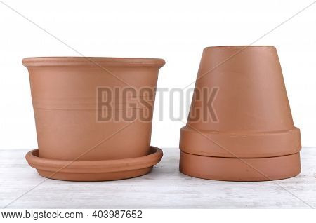 Terra Cotta Flower Pots Empty  On A Table On White Background