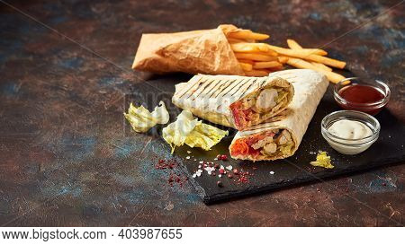 Eastern Traditional Shawarma, Doner Kebab With Chicken And Vegetables And French Fries With Sauces O