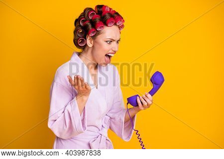 Profile Side View Portrait Of Pretty Evil Mad Fury Woman Wearing Curlers Talking On Phone Yelling Is