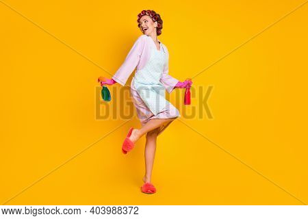 Full Length Body Size View Of Attrcative Cheerful Housemaid Using Chemical Jumping Isolated On Brigh