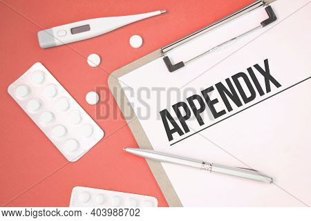 Notebook Page With Text Appendix On A Table With A Pills And Pencil, Medical Concept, Top View