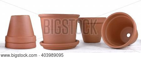 Group Of Terra Cotta Flower Pots Empty In Panoramic View  On White Background