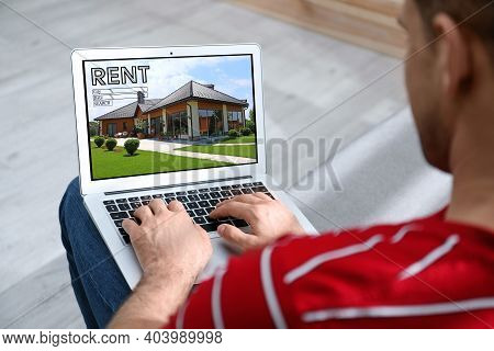 Man Searching For House On Rental Property Website Via Laptop, Closeup
