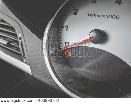 Check Engine Light On Car Dashboard Close Up Background