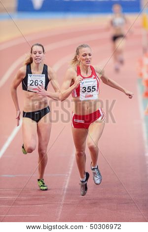 VIENNA, AUSTRIA - JANUARY 29 Line Kloster (#355 Norway) places 3rd in the women's 400m event on January 29, 2013 in Vienna, Austria.