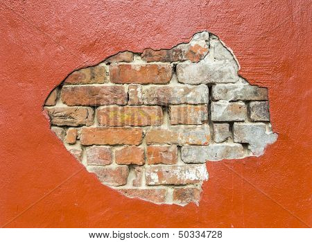 damaged red wall with bricks under plaster poster