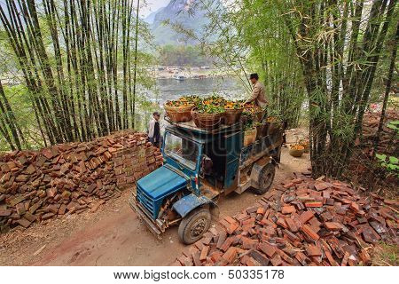 Vintage Blue Truck, Laden Of Oranges In Wicker Baskets, China.