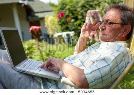 Senior Man Using Computer Outdoor