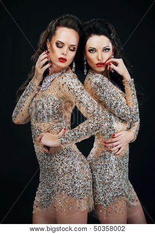 Luxury. Two Sexy Glamorous Women In Shiny Dresses