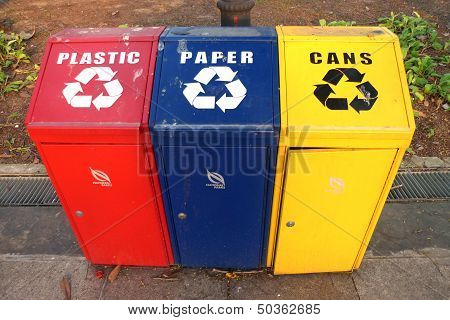Multi coloured recyclling bins for plastic paper and cans poster