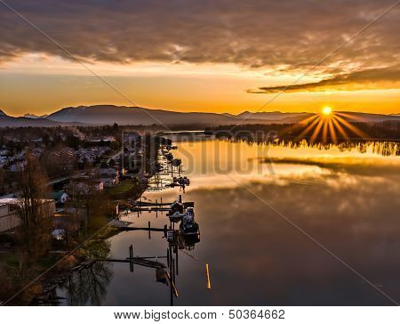 Sunrise Star Next To River With Boats
