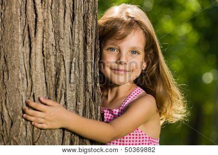 Little Girl Near A Tree