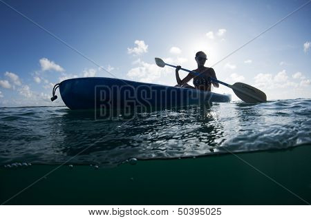 Woman in a Sea Kayak on the Ocean
