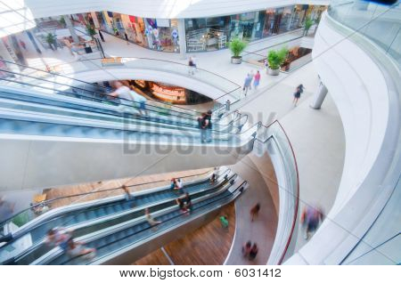 Modern shopping mall. People in rush. Big city life. poster