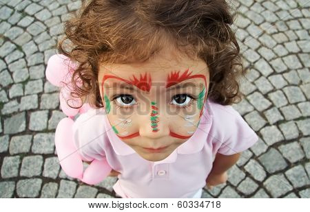 Little Girl With Face Paint Looking Up