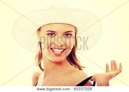 Beautiful young caucasian woman in swimsuit and hat, isolated on white background