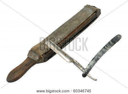 Old (rusty) straight razor with strop isolated on white. poster