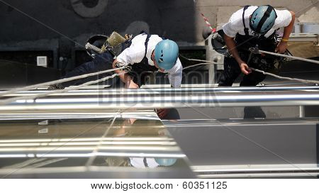 Climbers On Office Building