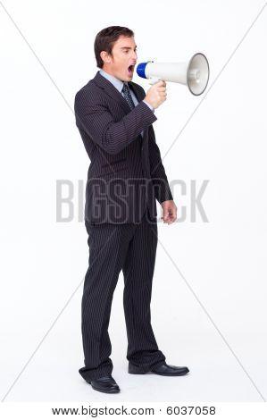 Standing Businessman Shouting Through A Megaphone
