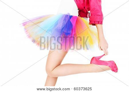 A picture of a woman in a colorful ballerina dress and pink heels posing over white background