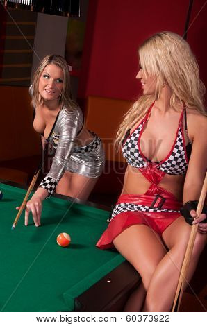 Girls playing in billiard