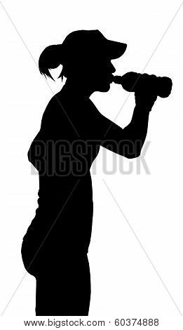 Thirsty Sports Woman Taking A Drink From A Bottle