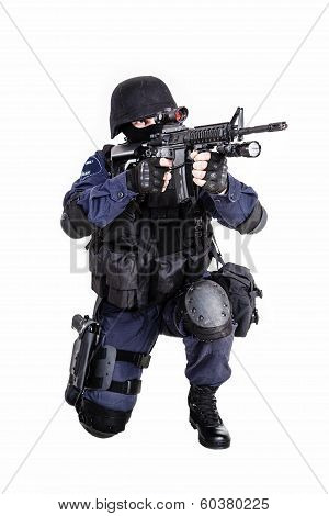 Special weapons and tactics (SWAT) team officer with his gun poster