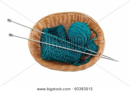 Ball Of Wool And Knitting In The Basket For Needlework On A White Background