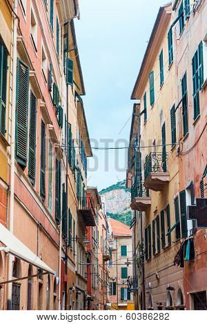 Finale Ligure (Savona Liguria Italy) old typical street with colorful houses poster