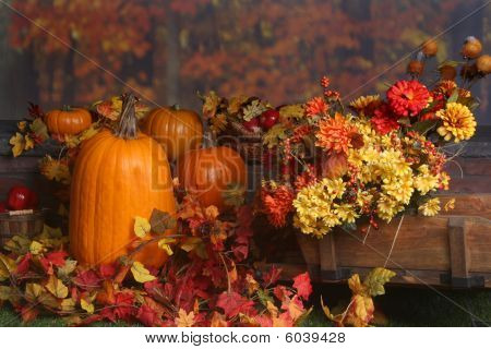 Autumn Scene With Pumpkins And Colored Leaves