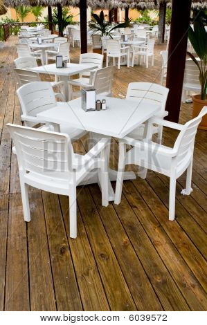 Many White Plastic Chairs And Tables