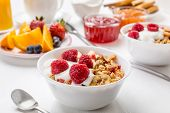 Healthy Breakfast Meal - Bowl of Fruit, Oat and Nut Granola  with Yogurt and Raspberries poster