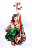 An Indian classical music singer in performance with the instrument called Tanpura. poster