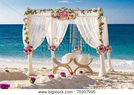 beach wedding set up, tropical outdoor wedding reception, beautiful cabana, wedding arch