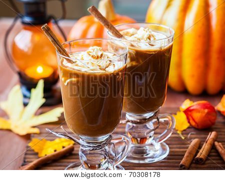Pumpkin spice coffee with whipped cream and caramel