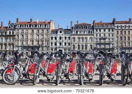 LYON FRANCE - AUGUST 2014 - Shared bikes are lined up in the streets of Lyon France. Velo'v Grand Lyon launched in May 2005 has over 340 stations and 3000 bikes throughout the Grand Lyon area.