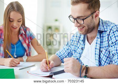 Man doing classwork at university