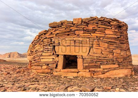 Ancient Tombs At Sunset In The Desert