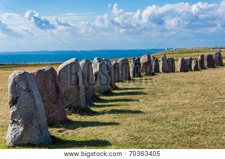 Ales Stenar in Kasaerga, Scania region, Sweden, mysterious circle created 1400 years ago. Consists of 59 large stones forming a circle resembling a ship shape. poster