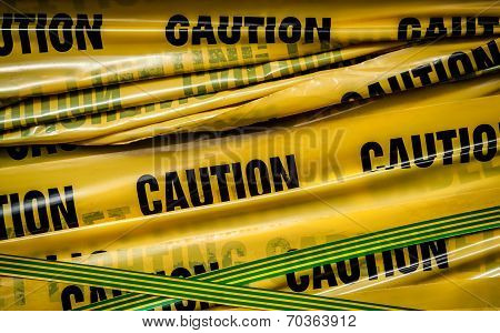 """abstract close-up photo of yellow """"caution"""" tape poster"""