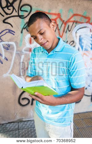 Young Sexy Male Reading A Book.