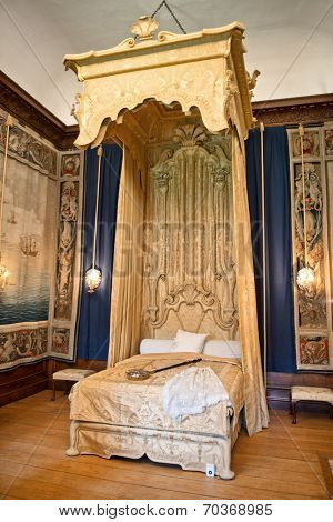 HAMPTON COURT, UK - AUGUST 03, 2014 - Baroque bed at state bedchamber at Hampton Court Palace near London on August 03, 2014
