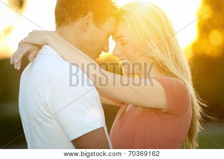 Loving young couple in glowing sunlight