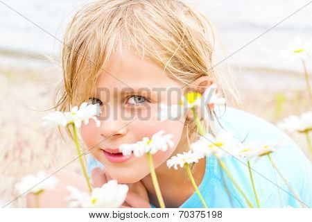 Pretty Little Blond Girl In A Patch Of Daisies