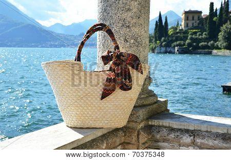 Basket bag against lake Como, Italy