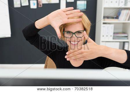 Creative Businesswoman Creating A Frame