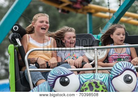Girls On Carnival Ride At State Fair