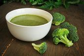 Broccoli soup in a white bowl with fresh vegetables ready to eat poster