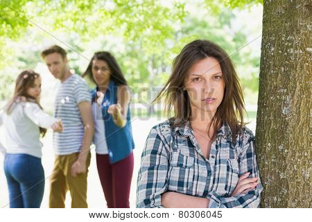 Lonely student being bullied by her peers at the university